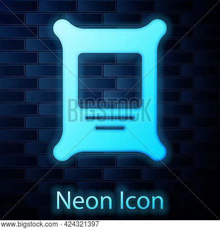 Glowing Neon Fertilizer Bag Icon Isolated On Brick Wall Background. Vector