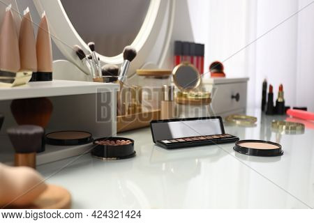 Many Different Cosmetic Products On Dressing Table Indoors