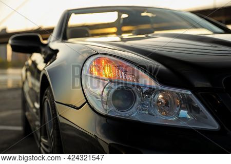 Luxury Black Convertible Car Outdoors, Closeup View