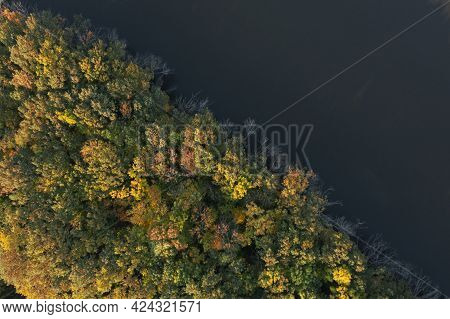 Aerial View Of Beautiful Autumn Forest On Riverbank