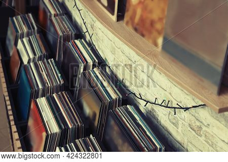 Rack And Shelf With Different Vinyl Records In Store
