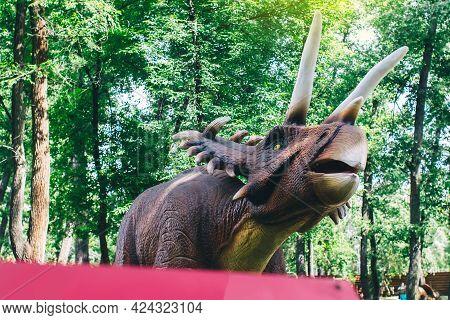 Close-up Of An Extinct Triceratops Dinosaur Made Of Rubber And Metal. Animatronics And Robotics. Ani