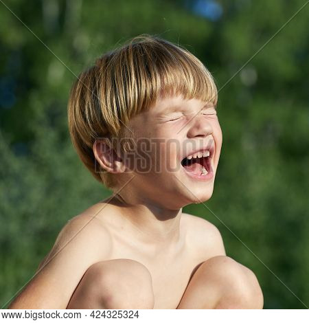 Portrait Of Little Angry Boy Shouting And Screaming In Outdoor