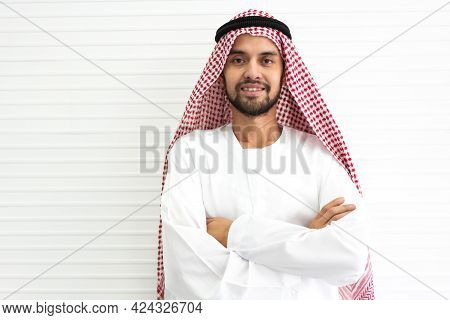 Portrait Of Happy Smiling Handsome Middle Eastern Arab Man In Traditional Clothing Standing On White