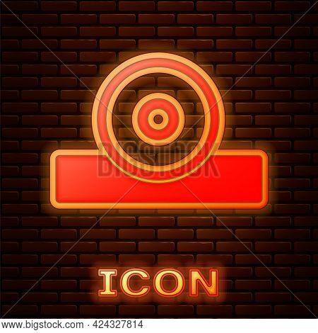 Glowing Neon Otolaryngological Head Reflector Icon Isolated On Brick Wall Background. Equipment For