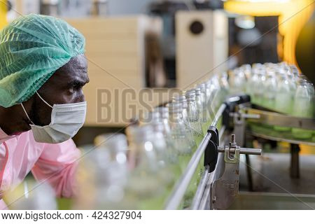 Food And Drug Quality Supervisors Inspect Quality In Factory. Staff Wear Masks And Helmets For Clean