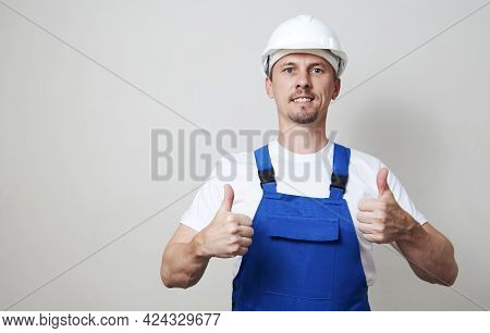 Portrait Of Young Handyman Standing On White Background