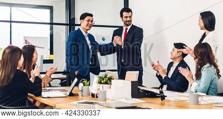 Image Two Asian Business Partners In Elegant Suit Successful Handshake Together In Front Of Group Of