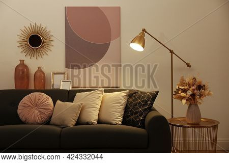 Stylish Living Room Interior With Comfortable Sofa And Floor Lamp