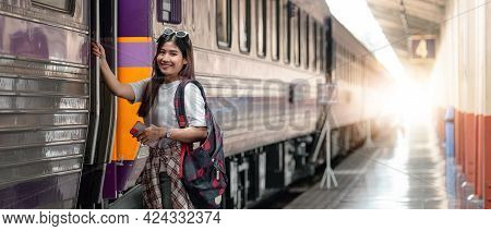 Portrait Attraction Asian Woman Boarding A Train At Train Station For Travel In Summer. Travel Conce