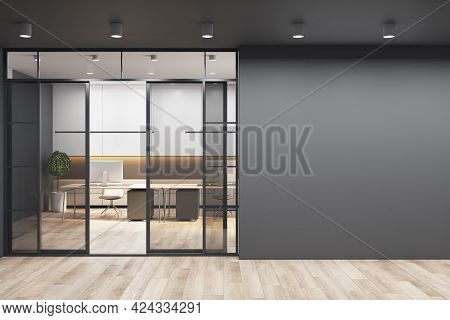 Black Wall With Copyspace For Your Text Or Logo Next To Doors To Sunny Office With Monochrome Style
