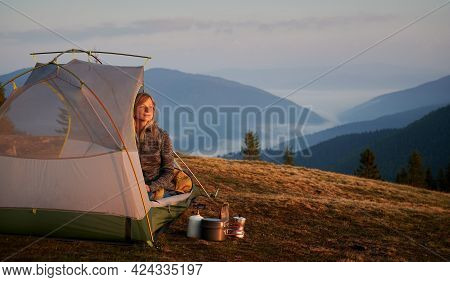 Beautiful Woman With Interested Facial Expression Watching For Stunning Mountain Scenery From Her Te