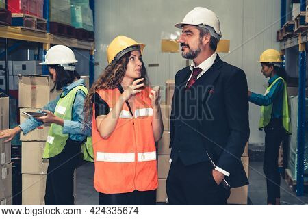 Warehouse Senior Manager Talking To Worker In The Storehouse . Logistics , Supply Chain And Warehous