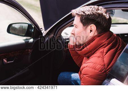 Man Calling Repair Service After Car Breakdown.youg Man Talking On Cell Mobile Phone On Road. Broken