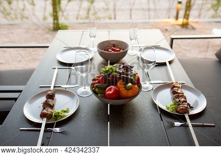 A Picnic On The Terrace For Friends.terrace With Barbecue At Sunset.fried Meat On The Street At Home