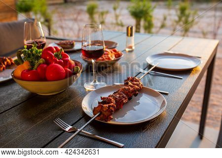 Laid Table With Food On The Summer Terrace.food On The Terrace At Sunset.dinner At Home With Friends