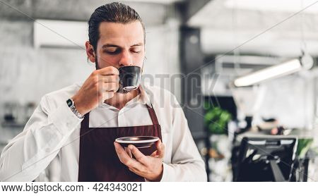 Portrait Of Barista Man Small Business Owner Holding Cup Of Coffee In The Cafe Or Coffee Shop.male B