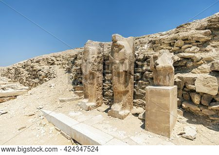 Egyptian Statues Of The Pharaohs Near The Pyramid Of Djoser. Large Blocks And Fragments Of An Egypti
