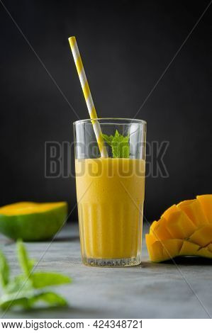 Mango Juice In Glass With Fresh Mango Sliced Fruit And Mint Leaves