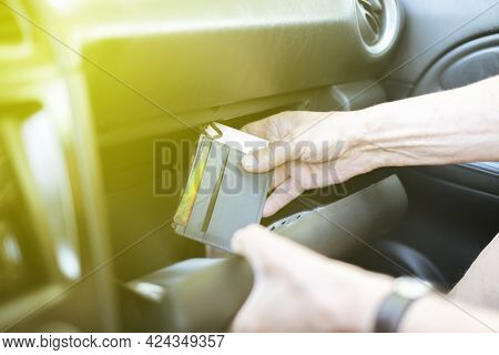 The Persons Hand Take Wallet Cash And Credit Card From The Glove Compartment In The Car