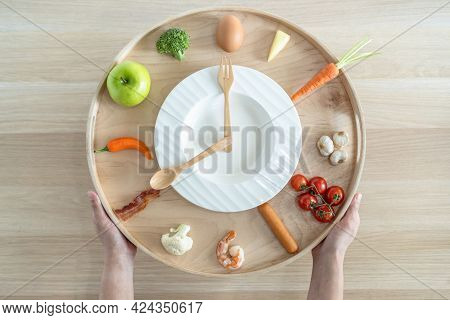 Iintermittent Fasting If And Keto Diet Concept With Hour Clock Timer For Eating Nutritional Or Ketog