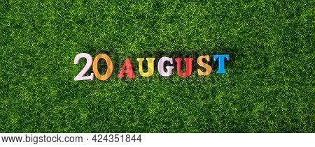 August 20. Image Of Wooden Colored Letters And Numbers On August 20 Against The Background Of A Gree