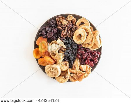 Various Dried Fruits And Berries. Dried Or Sun-dried Berries And Fruits On Plate On White Background