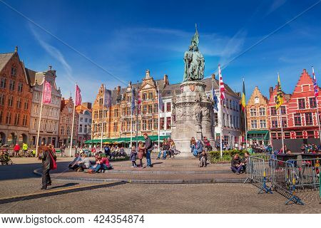 Bruges, Belgium - April 10, 2016: Market Place Or Grote Markt Square With Colorful Traditional House