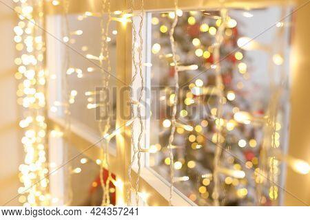 New Year's And Christmas. Greeting Card. Christmas Garland On Window