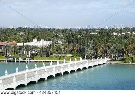 The View Of A Bridge Entering To Residential Palm Island In Miami (florida).
