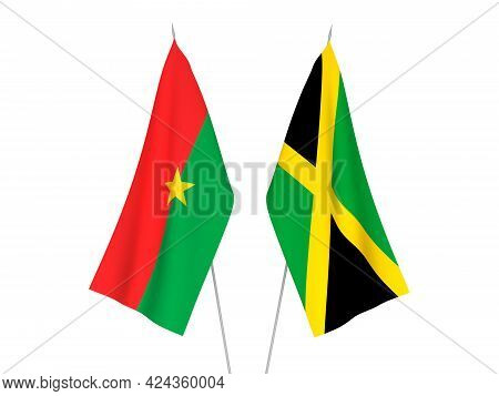 National Fabric Flags Of Jamaica And Burkina Faso Isolated On White Background. 3d Rendering Illustr