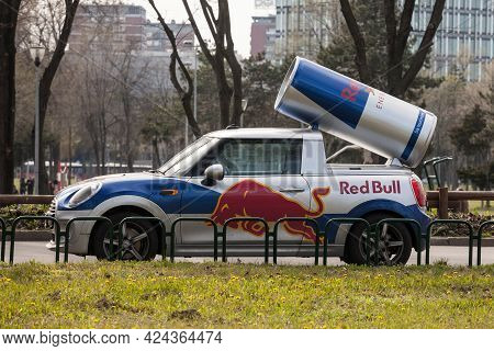 Belgrade, Serbia - March 27, 2021: Logo Of Red Bull On A Giant Promotional Can On A Car.red Bull Is