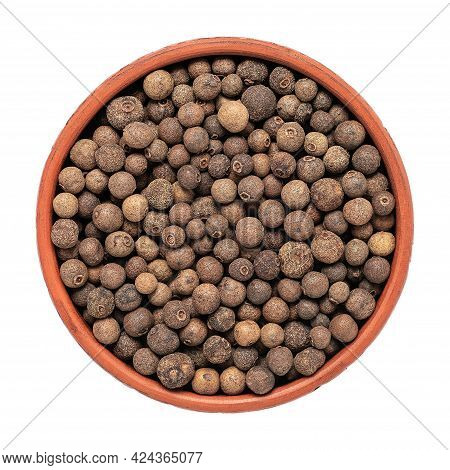 Allspice In A Bowl Isolated On White Background. Top View. Peppercorns