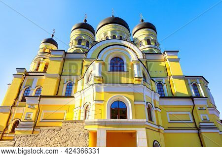 Church Painted In Yellow . Monastery Hincu From Moldova . Architecture With Domes . Religious Buildi
