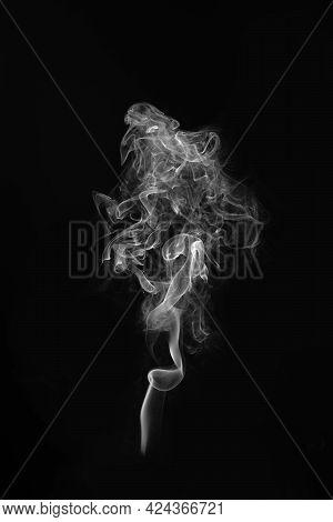 Close Up Smoke On A Black Background.