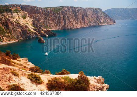 Beautiful Sea Coast With Turquoise Water And Rocks. View Of Jasper Beach In Fiolent Cape, Crimea. Su