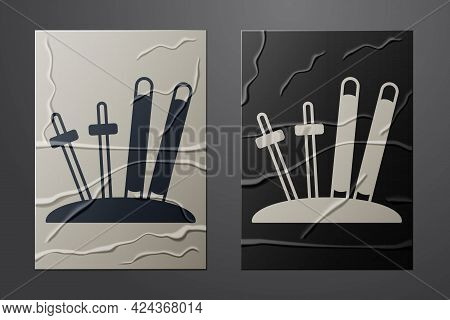 White Ski And Sticks Icon Isolated On Crumpled Paper Background. Extreme Sport. Skiing Equipment. Wi