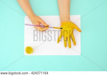 Children's Pens Are Painted With Bright Colors On Paper. Children's Handprint. Bright Background