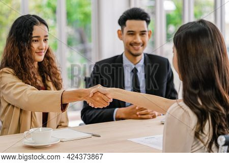 Closeup Handshake After Interview Agreement Between Young Asian Woman And Two Manager With Positive