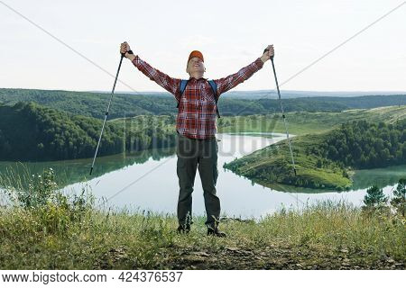 Happy Man Hiker With Hands Up On Summer Nature Background. Freedom, Healthy Active Lifestyle Concept