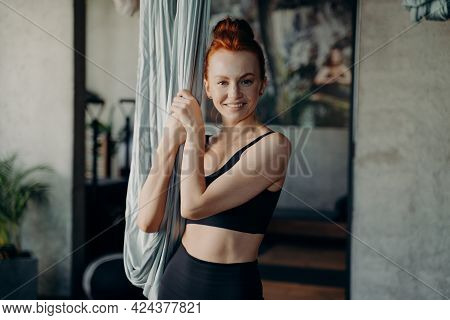 Portrait Of Active And Healthy Ginger Woman Looking Happily At Camera While Standing By Hammock, Wai