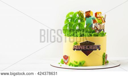Birthday Cake For A Fan Of Minecraft Game On White Background. Cake For A Gameboy Decorated With Edi