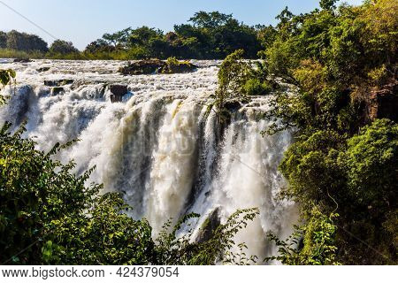 Grand Victoria Falls. Victoria is a waterfall on the Zambezi River in South Africa. Located on the border of Zambia and Zimbabwe. Concept of active, extreme and photo tourism