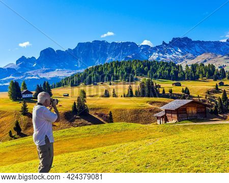 Alpe di Siusi is charming plateau in the Dolomites, Italy. Beautiful sunny day for hiking and taking photos. Alpine shepherd's hut. The concept of walking, ecological and photo tourism