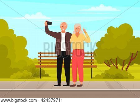 Elderly Couple Holding Mobile Phone And Taking Pictures. Aged Persons Smiling And Posing For Photo S