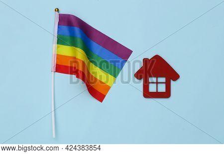 Lgbt Rainbow Flag And House On Blue Background. Tolerance, Freedom