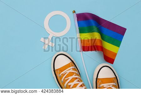 Lgbt Rainbow Flag And Sneakers, Female Symbol On Blue Background. Tolerance, Freedom, Gay Parade. To