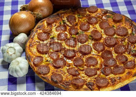 Pepperoni And Cheese Pizza And Tarantella Sauce. Culinary Delicacy. Homemade Pizza. Typical Italian