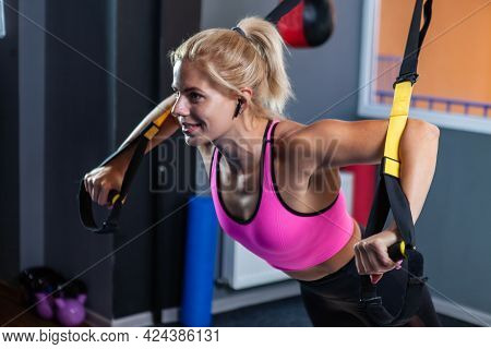 Sporty Women Training With Fitness Trx Straps In The Gym. Suspension Straps Training.