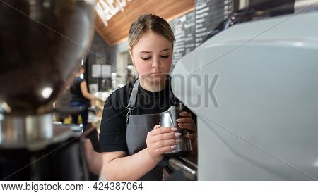 A Barista Steams Milk In A Coffee Machine In A Cafe In The Morning. Steaming Process With A Steam Pi